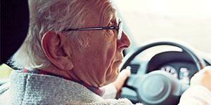 elderly man driving